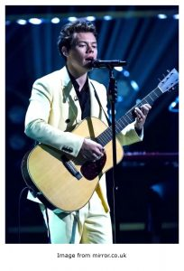 Harry Styles wore a bright Yellow suit.